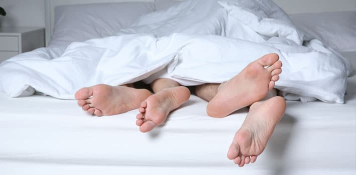 How long should sex last? couples in bed
