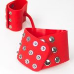 close up red studded silicone handcuffs wristcuffs